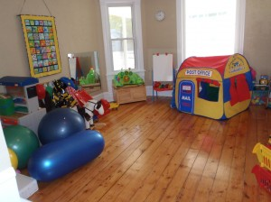 This is the front room where a lot of imaginary play happens. We have dress up clothes, a play tent, legos, building blocks and so much more!