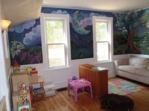 This is the main room where we have a reading corner and another area for small group play.