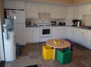 Area for snacks, meals and getting messy! We do fine motor activities in here, such as painting and coloring.